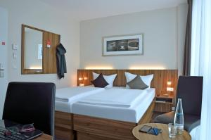 A bed or beds in a room at Best Western Hotel Berlin Mitte