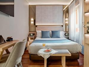 A bed or beds in a room at Preciados