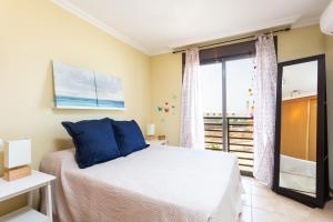 A bed or beds in a room at Home2Book La Tejita Beach and Pool
