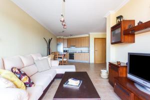 A seating area at Home2Book La Tejita Beach and Pool