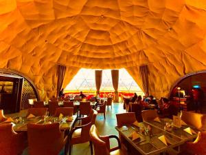 A restaurant or other place to eat at Wadi Rum UFO Luxotel