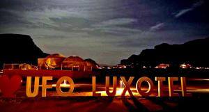 The logo or sign for the luxury tent