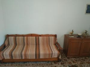 A bed or beds in a room at Piraeus House Next Suburban Train