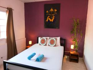 A bed or beds in a room at Bodhi Hostel & Lounge