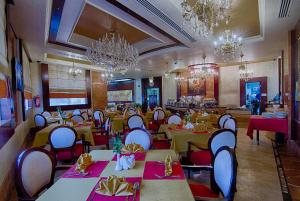 A restaurant or other place to eat at Chairmen Hotel