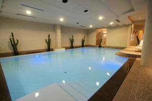 The swimming pool at or near Adler Family & Wellness Clubresidence