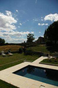 The swimming pool at or near Le Clos Des Rêves