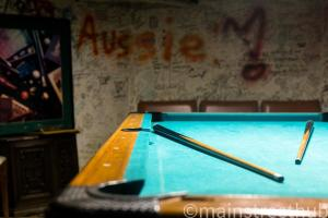 A pool table at Hilltop Hostel
