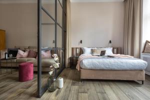 Un ou plusieurs lits dans un hébergement de l'établissement Fragola Apartments Old Town