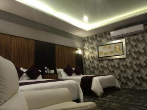 Cama o camas de una habitación en Hotel Aguascalientes