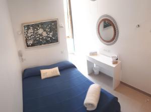 A bed or beds in a room at Hôtel Du Soleil