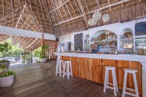 The lounge or bar area at El Pez a Colibri Boutique Hotel