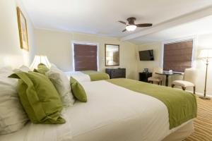 A bed or beds in a room at Coast Village Inn