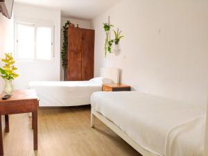 A bed or beds in a room at Casa Londres