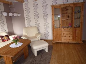 Ein Sitzbereich in der Unterkunft Ferienhaus Jungclaus