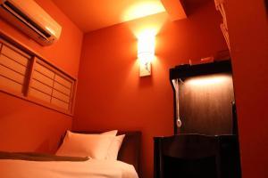 Een bed of bedden in een kamer bij Chiyoda Inn
