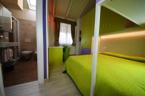 A bed or beds in a room at Family Hotel Primavera