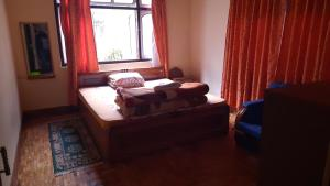 A bed or beds in a room at Chungthang Teesta Homestay