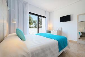 Cama o camas de una habitación en azuLine Hotel Bergantin