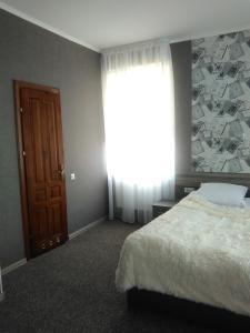 Un pat sau paturi într-o cameră la Yurus Hostel