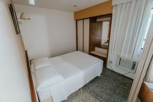 A bed or beds in a room at Iracema Residence Flat