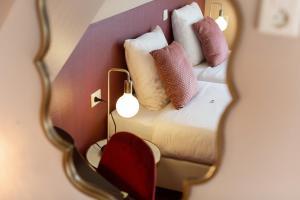Un ou plusieurs lits dans un hébergement de l'établissement Strandhotel Scheveningen