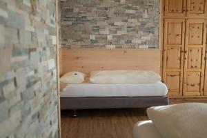 A bed or beds in a room at Meublè Garnì Della Contea