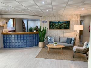 De lobby of receptie bij Apartamentos Guadiana