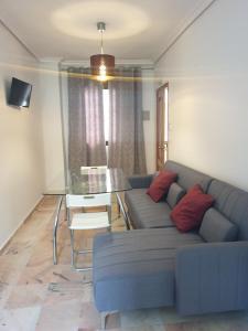 A seating area at Hotel y Apartamentos Doña Lola