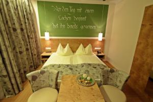 Ein Bett oder Betten in einem Zimmer der Unterkunft Hotel-Restaurant Forellenhof