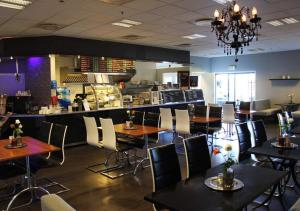 A restaurant or other place to eat at Aalesund Airport Hotel