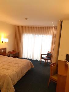 Uma cama ou camas num quarto em Hotel dos Loios