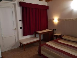 Letto o letti in una camera di Ca' Del Sasso