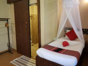 A bed or beds in a room at Ombak Resort Perhentian Island
