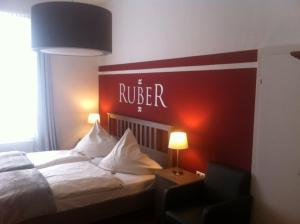 Ein Bett oder Betten in einem Zimmer der Unterkunft Dinoris Boutique Hotel