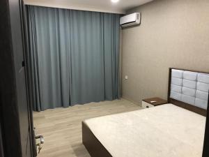 Cama ou camas em um quarto em Superior Apartment on Nizami Street