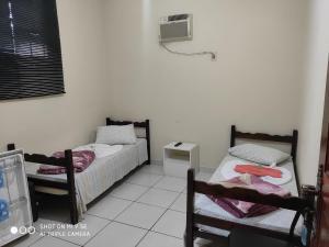 A bed or beds in a room at Pousada da Iza