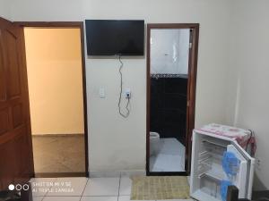 A television and/or entertainment centre at Pousada da Iza