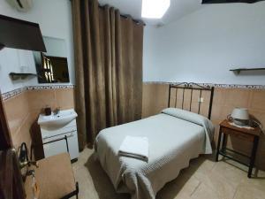 Cama o camas de una habitación en Pensión Javier