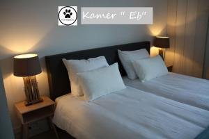 A bed or beds in a room at Zilt Texel