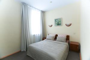 Кровать или кровати в номере Отель Нео