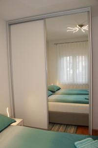 A bed or beds in a room at Apartment Zarko