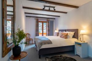 Un ou plusieurs lits dans un hébergement de l'établissement Hotel de la Poste