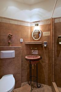 Ein Badezimmer in der Unterkunft Alice Apartment House