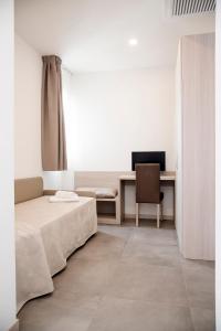 Letto o letti in una camera di Hotel Solemare