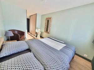 Un ou plusieurs lits dans un hébergement de l'établissement Les Chamois
