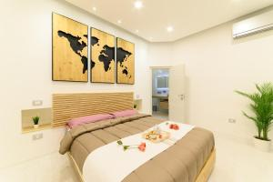 A bed or beds in a room at Luxury Apartment Salerno Center
