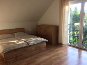 Posteľ alebo postele v izbe v ubytovaní Apartments ADANA