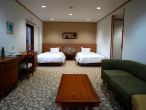 A bed or beds in a room at Wisterian Life Club Verde no Mori