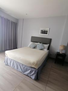 A bed or beds in a room at Down South 118 Beach Resort